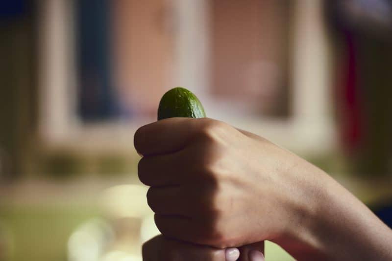 Female holding cucumber